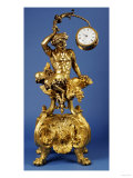 An Ormolu Mantel Clock with a Shaped Rectangular Base on Four Lion's Paw Feet