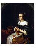 A Woman Knitting with a Basket of Fruit on a Carpet-Covered Table Beside Her