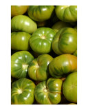 Green tomatoes at a vegetable market
