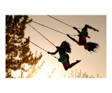 Girls Swinging at Sunset