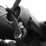 "Actor Steve McQueen Filming ""The War Lover"" Standing by Flying Fortress at RAF Bovingdon Aerodrome"