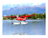 Red Floatplane landing in Anchorage Alaska