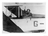 Amy Johnson (Mrs Mollison) Sits in Her Plane and Smiles and Waves to the Camera