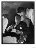 """An Attentive """"Swissair"""" Air Hostess Serves a Smart Gentleman a Cup of Coffee"""