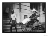 Man Wearing a Pith Helmet Being Transported by Rickshaw Probably in India