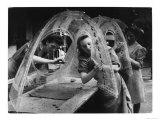 Three Women Assemble Aircraft Gun Turrets