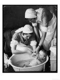Two Nurses Bath a Baby