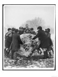 Group of Schoolboys and Girls in Caps Hats and Overcoats Rolling a Dirty Great Snowball!