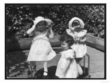 Three Little Girls in White Dresses with Matching Hats