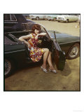 Girl in a Classic Racing Green &quot;MGB&quot; Sports Car