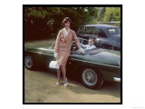 Girl in a Smart Summer Suit Poses Next to Her Boyfriend's MGB Sports Car
