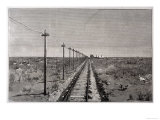 Telegraph Lines Running Alongside a Railway at a Remote Station in the Great Plains of America