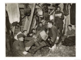 British Soldiers off Duty Smoking and Listening to an Accordion at the Front Somewhere in Flanders