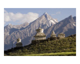 White Buddhist stupas with Snow Capped Zanskar range mountains