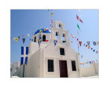 Chuch with flags in the city of Oia on Santorini