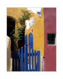 Colorfully Painted House with a Blue Fence in Santorini  Geece