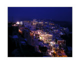 City on Hillside at Night in Santorini  Greece