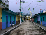 Painted Row of Houses with Distant Chapel in Acatlan  Veracruz  Mexico