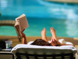 Woman Reading by Hotel Swimming Pool  Las Vegas  Nevada  USA