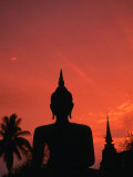 Buddha Against a Sunset at Wat Mahathat  Sukhothai  Thailand