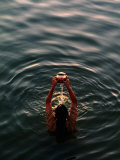 Woman Pouring Water During Morning Puja on Ganges  Varanasi  India