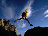 Hiker Jumping Between Rocks in the Wasatch Mountains  Wasatch-Cache National Forest  Utah  USA