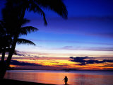 Couple Walking Along Beach at Sunset  Fiji