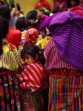 Women and Young Girl Watching the Zunil Easter Procession  Zunil  Guatemala