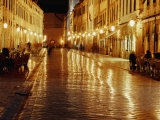 People Sitting at Tables on Placa at Night  Dubrovnik  Croatia