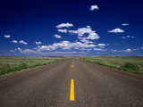 Road Leading to Horizon Beneath Blue Sky  USA
