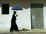 Man Walking with Umbrella  St Louis  Senegal