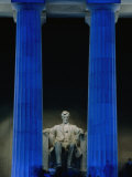 Abraham Lincoln Statue Between Blue Floodlit Columns of Lincoln Memorial  Washington Dc  USA