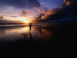 Man Jogging on Seminyak Beach at Sunset Seminyak  Bali  Indonesia