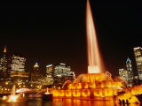Gold Lights of Buckingham Fountain in Grant Park with City Skyline in Background  Chicago  USA