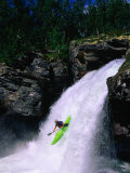 Kayaker Going Down Waterfall of Store Ula River  Rondane National Park  Norway