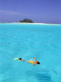 Woman Snorkelling at Sea Surface Cocos Keeling Island in Background  Indian Ocean  Australia
