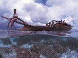 Bajau Fisherman on Lepa Boat in Shallow Water Over Coral Reef  Pulau Gaya  Borneo  Malaysia
