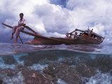 Bajau Fisherman on Lepa Boat in Shallow Water Over Coral Reef  Pulau Gaya  Borneo  Malaysia