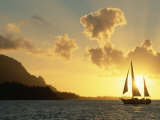 Sailing Yacht at Sunset off Coast of Hanalai Bay  Kauai  Hawaii  USA