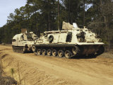 An M-88 Recovery Vehicle Begins to Tow an M992 Field Artillery Ammunition Supply Vehicle