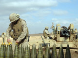 A US Marine Prepares Howitzer Rounds to be Fired Near Baghdadi  Iraq  January 6  2007