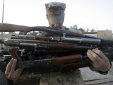 A Marine Readies 80 Pounds of Enemy Rifles Seized August 6