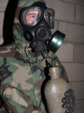 A Marine Drinks Water from His Canteen Through His Gas Mask Inside the Gas Chamber