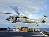 An MH-60s Seahawk Helicopter Prepares to Deliver Ammunition