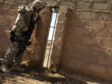 US Army Sergeant Looks for a Sniper Who Has Fired Rounds in the Area During a Patrol