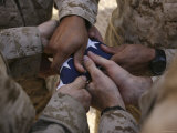 Marines Fold an American Flag after It was Raised in Memory of a Fallen Soldier