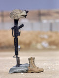 Boots  Rifle  Dog Tags  and Protective Helmet Stand in Solitude to Honor Fallen Soldiers