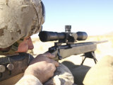 A Soldier Aims in with His M40A3 Scout Sniper Rifle While Taking Shots at Green Ivan Targets