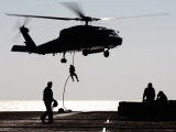 Personnel Fast-Rope out of an SH-60F Seahawk Helicopter