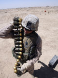 A Marine Handles a String of 40 mm High-Explosive Grenades